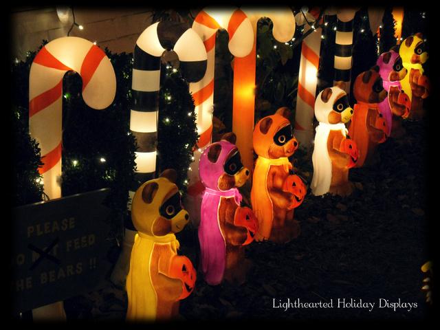 Turning random Christmas blowmolds into whimsical Halloween decorations.-hallowen-candy-canes-1-.jpg