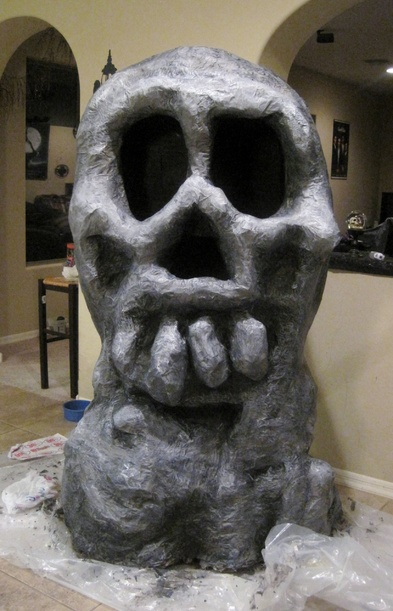 Paper mache skull rock for pirate scene for Papier mache rocks