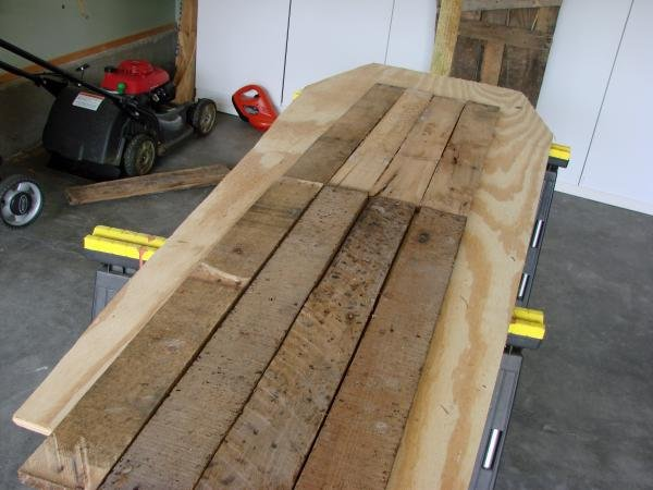 Lay out the side wood to get ready to screw together using the plywood bottom as a working table. Make sure that you have enough wood to make the side
