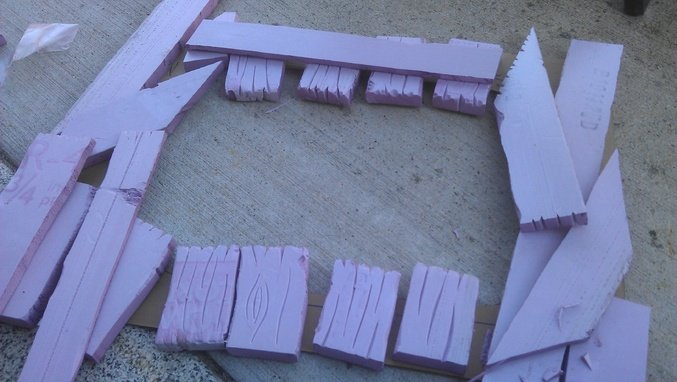 "This is the beginnings of a 'monitor bezel'-- it goes around the screen.  This is 3/4"" pink insulation foam that I've cut with a hot knife and st"