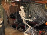Skeleton on a motorcycle