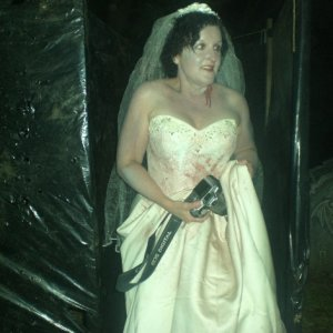 The Dead Bride apprehensively enteres the cemetery..........