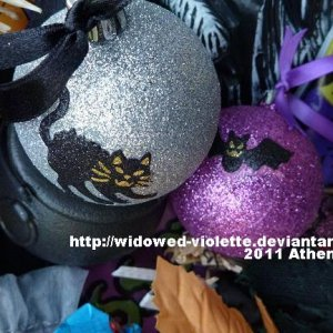Customized glitter baubles. Bats and Cats! I added stickers and double sided satin ribbons to them.