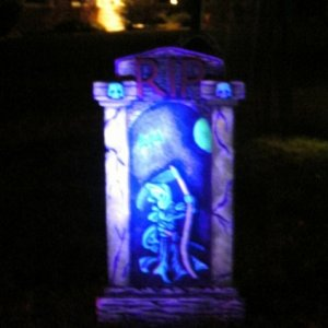 Tombstone with glow in the dark paint and UV spotlight