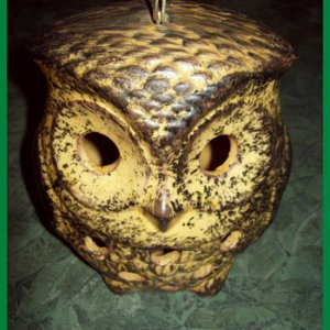 Owl candle-holder.
