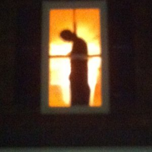 Hanging Man in Upstairs Window