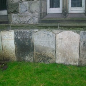Gravestones set into the wall of the church.