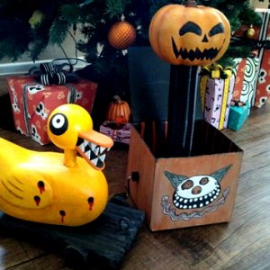 "Nightmare Before Christmas: Jack-in-the-box/Jack-o-lanturn & Undead/Bullet hole Duck,  Seen during the ""Making Christmas"" song  http://d"