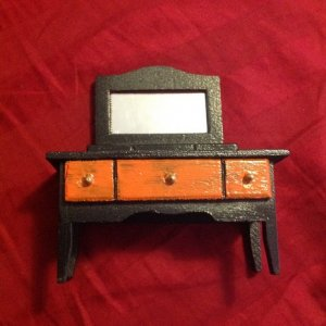 an awesome Halloween themed dollhouse vanity/dresser. It is so wonderfully done. I can't wait to get it all set up.