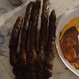 This is a shot of the painted hand before I began applying cloth. For colors I used a mixture of pthalocyanine blue, burnt umber, cadmium yellow, cadm
