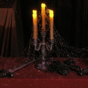 Candelabra, swords and cobwebs.