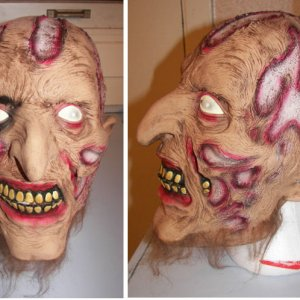 Mask with original paint and witch nose .