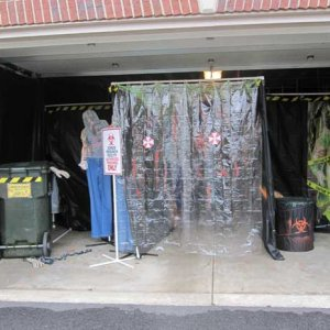 The finished garage entrance.  Used clear shower curtains and made Resident Evil umbrella stickers on the front.