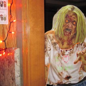 Zombie prop hanging out at the party.