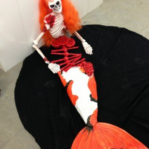 A dead/partially eaten mermaid we will lay on the bridge over our Koi pond. (made from a cheap plastic skeleton and paper mache).