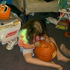 A 5-6 year old me trying my hardest to carve an pumpkin using a Pumpkin Masters pattern