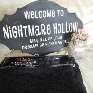 Nightmare Hollow sign, spider web table runner, and my ashes of an innocent jar