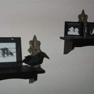 Far left frame has verse from The Raven.  Right shelf has reverse silhouettes.