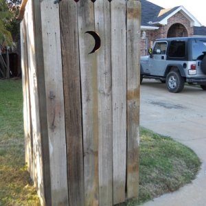 OUTHOUSE Build: Built from old free fence scrap found piled by the curb.   Remove old nails, cut off any rotten ends, add a screen door hinge to the d