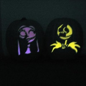 My Jack & Sally jack-o-lanterns, lit.