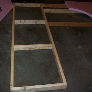 The frame is just a simple 2x4 construction held together with drywall screws.  I have to take it apart each year for storage purposes.  It is 8' tall