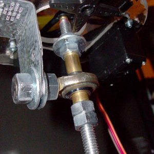 All-thread attached to Rod-end attached to mounting bracket attached to polycarbonite.  Note: Washer at the top of the all-thread has a hold drilled i