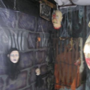 Head in a bag, dropping Donna, Hook Head and a prisoner in a cage has red LED eyes.  Lots of black lights in the dungeon and ceiling is a white sheet