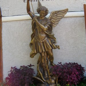 THe park's beautiful statue of Michael slaying Lucifer fit right in.