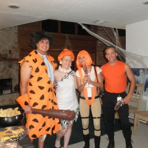 Corbin Dallas & Leelu from the Fifth element, along with Fred & Wilma Flinstone
