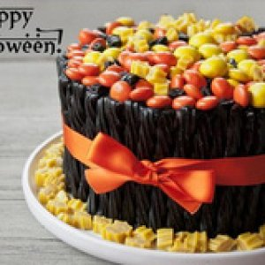 Halloween Twizzler Cake Step 1:  Bake a cake and cover it in frosting. TIP: Do not use white frosting! Make sure your icing is dark in color or use ch