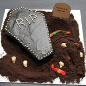 Coffin Cake   Chocolate Cake Mix  (prepare & follow directions) 2 cups chocolate frosting 6–8 drops black gel food coloring (Wilton)  Silver drage