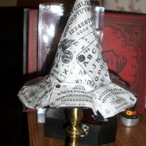 020 here is the hat displayed on the candle holder the way saki suggested.  very cute indeed