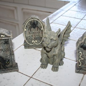 mini tombstones and gargoyle from yard sale