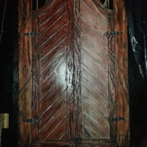 Our haunted doors made out of styrofoam, some paint and stain