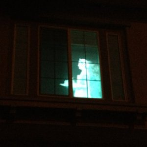 HauntedHotel2013. Rona Ghost Maid projection from Dminor running in one of the hotel rooms. Another hotel room had a vintage ghostly mother with baby