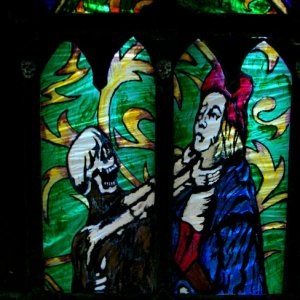 Updated Gothic window from 2012 . The stained glass was added to make it part of the Orphanage theme . Close up of the dance of death mid  section . T