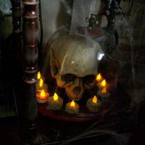 Skull under dome with candles .