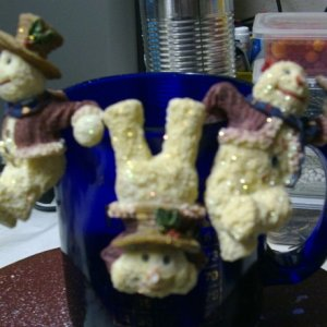 Some little snowmen that I think were made to hang on votive candles, I hung them on a coffee mug for the pic :)