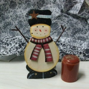 "Love this little snowman candle holder with a ""sweet cinnaroll"" candle, yummy!"