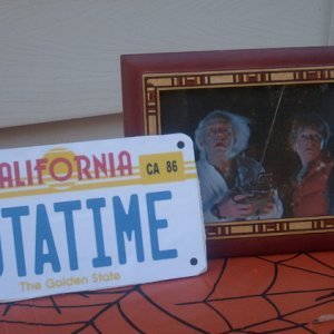 Exhibit: Dr Emmett L. Brown and Marty McFly, with the DeLorean's licence plate.