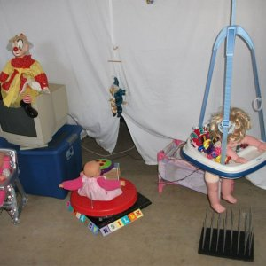 day view of nursery. the sit and spin is attached to a turntable so doll can go for a ride.