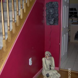 The entry way, check out the hideous burgundy/fuscia color combo that the previous owners loooooved!  Yikes!