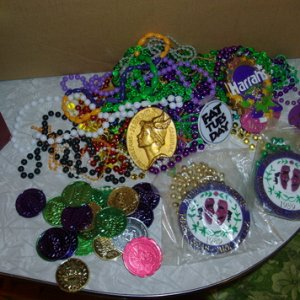My pile of Mardi Gras beads and coins that came in a purple gift bag