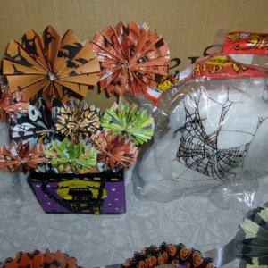 Cool paper flowers in a ceramic haunted house container
