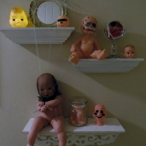 Creepy altered doll display in the bath.