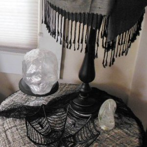 Packing tape skull, lampshade draped with a shawl, and a spider web bowl waiting to be filled with candy!