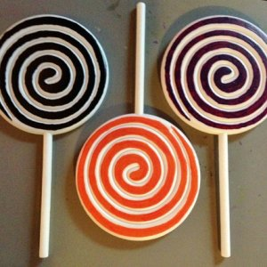 I painted Dollar Tree fake lollipops (originally red stripe) in black, orange, and purple.