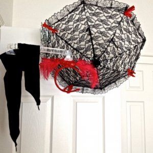 BuyCostumes, 2014. Circus Cutie included accessory pieces, umbrella, head piece, fingerless gloves and black fishnet stockings (not pictured)