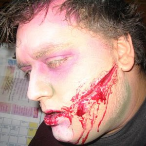 Hubby as zombie. Low-budget makeup, b/c we paid for it ourselves.