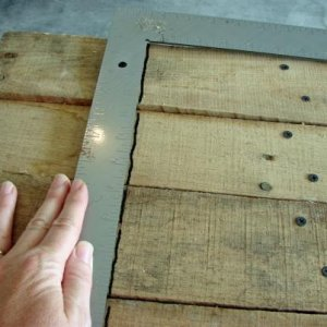 Using a square, mark off the needed amount. Cut off with a circular saw.